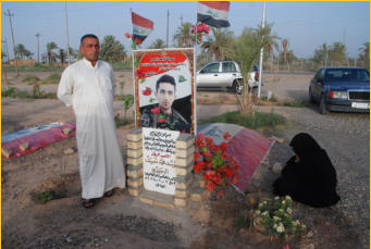 A father and mother mourn the loss of their son who was killed defending the town against ISIS.