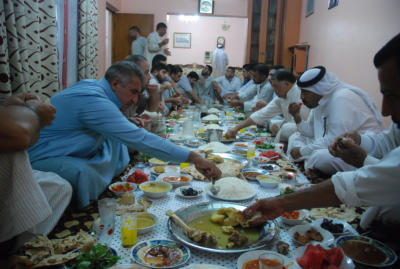 Eating the Iftar meal with my friends.  The food is excellent.