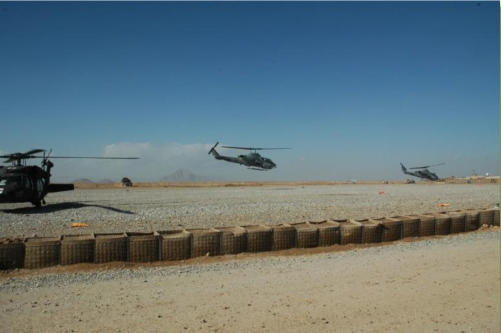 two USMC Cobra attack helicopters launch from FOB Edinburgh in Helmand Province