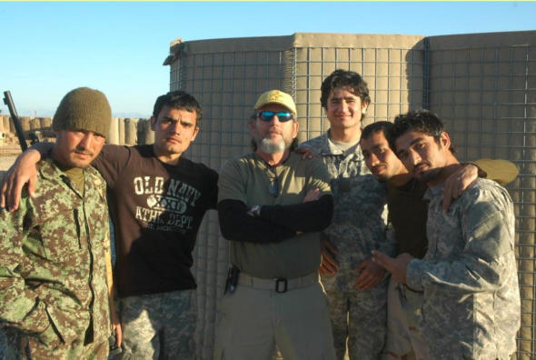 Jim Spiri, center, is seen with some Afghan National Army troops in Helmand province, March 1, 2012