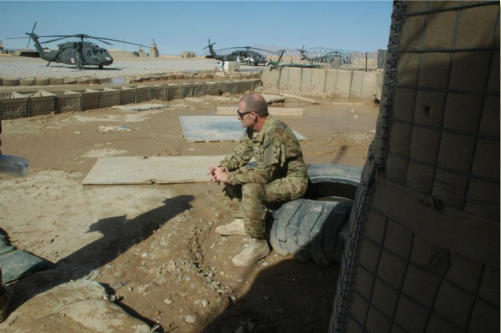 Medic Troy Hayes, from the Arizona National Guard takes time to think after the end of a mission