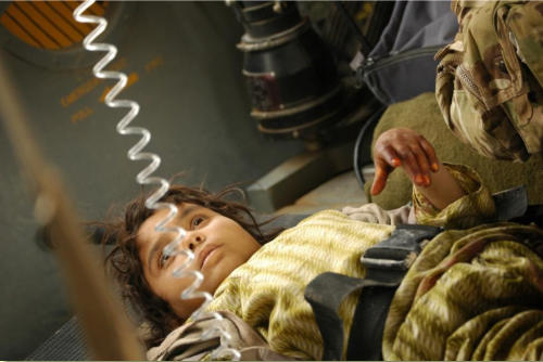 Little Afghan girl seen on litter in medevac helicopter, March 3, 2012,