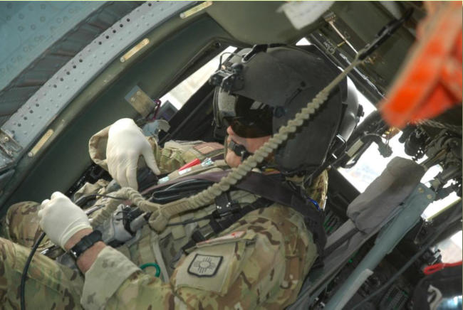 Sgt Heath Perry is seen here preparing for takeoff on medevac mission.