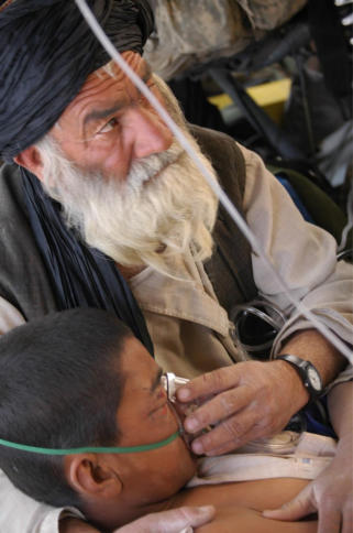 Father of local Afghan boy seen holding oxygen mask on his son