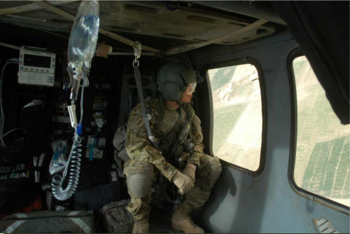 Flight nurse Capt. Andrew Kraus checks out the view on the way to pick up injured ANA soldier