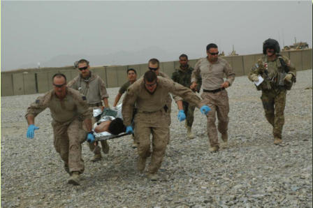 Marines carrying the injured ANA soldier to the helicopter